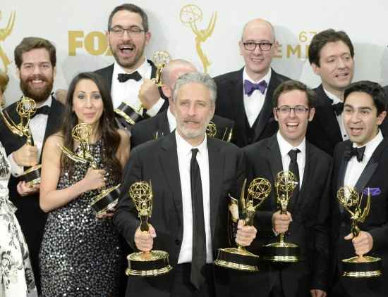 LOS ANGELES, CA - SEPTEMBER 20: TV personality Jon Stewart (C) and the writers of 'The Daily Show with Jon Stewart' , winners of Outstanding Variety Talk Series and Outstanding Writing for a Variety Series, pose in the press room at the 67th Annual Primetime Emmy Awards at Microsoft Theater on September 20, 2015 in Los Angeles, California.   Kevork Djansezian/Getty Images/AFP