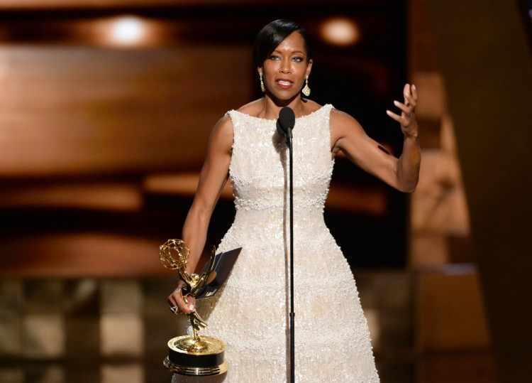 IMAGE DISTRIBUTED FOR THE TELEVISION ACADEMY - Regina King accepts the award for outstanding supporting actress in a limited series or a movie for ìAmerican Crimeî at the 67th Primetime Emmy Awards on Sunday, Sept. 20, 2015, at the Microsoft Theater in Los Angeles. (Photo by Phil McCarten/Invision for the Television Academy/AP Images) ORG XMIT: INVL
