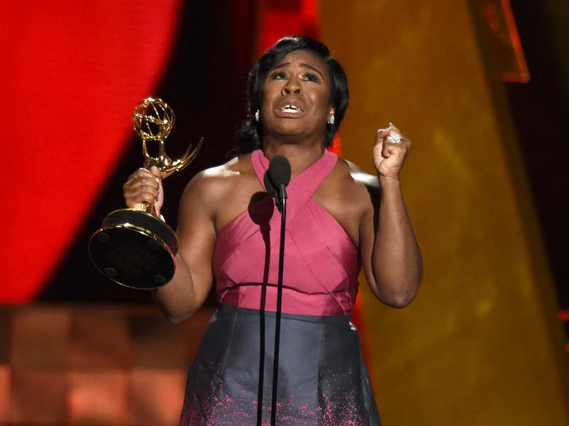 """Uzo Aduba accepts the award for outstanding supporting actress in a drama series for """"Orange Is The New Black"""" at the 67th Primetime Emmy Awards on Sunday, Sept. 20, 2015, at the Microsoft Theater in Los Angeles. (Photo by Chris Pizzello/Invision/AP)"""