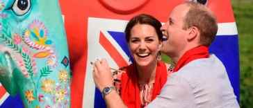 Britain's Prince William decorates an Elephant Parade statue as his wife Catherine, the Duchess of Cambridge, laughs during a visit to the Mark Shand Foundation at Kaziranga in the northeastern state of Assam, India, April 13, 2016. REUTERS/Biju Boro/Pool TPX IMAGES OF THE DAY
