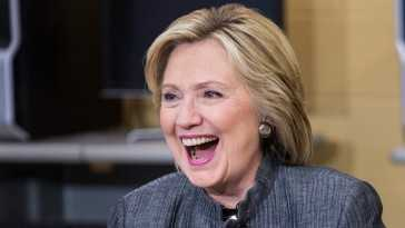 CONCORD, NH - APRIL 21:  Democratic presidential hopeful and former U.S. Sectetary of State Hillary Clinton (L) laughs while speaking with students and faculty of New Hampshire Technical Institute, Concord Community College, on April 21, 2015 in Concord, New Hampshire. The conversation revolved around higher education, manufacturing and women in the work force.  (Photo by Andrew Burton/Getty Images)
