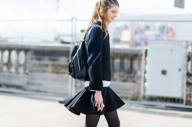 navy-and-black-backpack-black-mini-skirt-swing-skirt-skater-skirt-paris-fashion-week-street-style-fall-fashion-elle-640x426