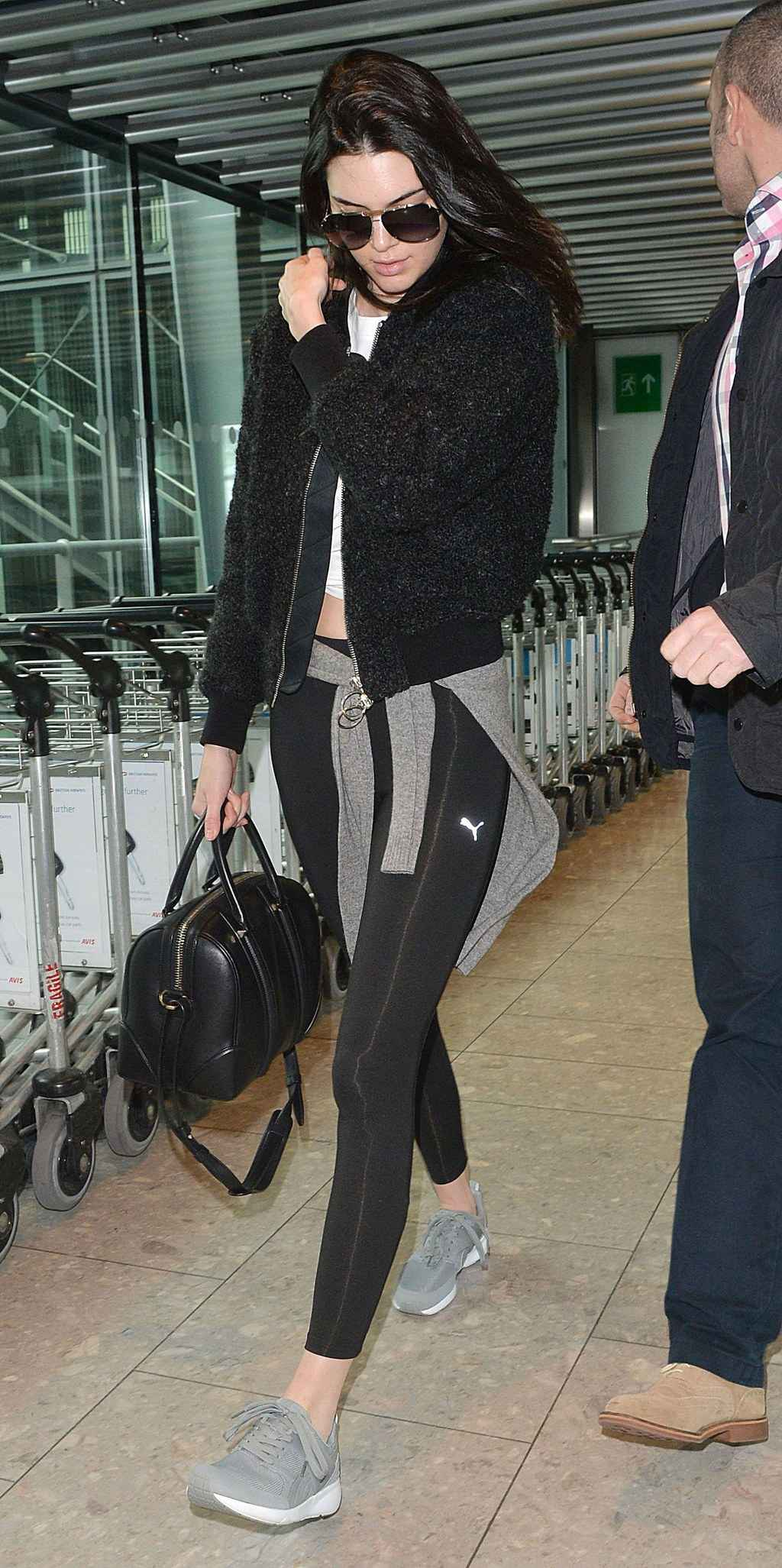 fashion-2015-07-kendall-jenner-workout-clothes-airport-outfit-style-main