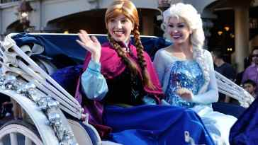 "LAKE BUENA VISTA, FL - DECEMBER 07: In this handout photo provided by Disney Parks, ""Anna"" and ""Elsa"" from the film ""Frozen"" particiapte in the Disney Parks Christmas Day Parade television special at Magic Kingdom Park at the Walt Disney World Resort on December 07, 2013 in Lake Buena Vista, Florida. The parade will air on December 25t. (Photo by Mark Ashman/Disney Parks via Getty Images)"
