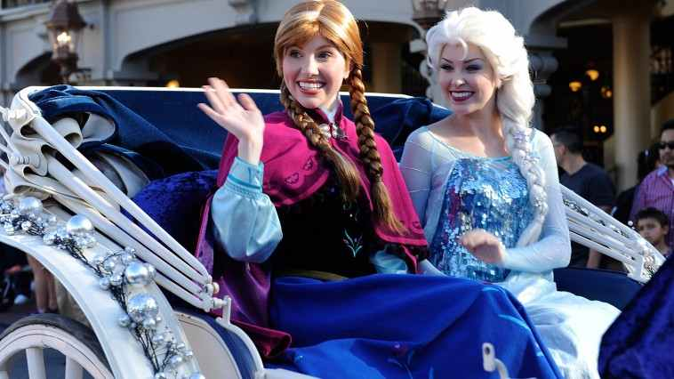 """LAKE BUENA VISTA, FL - DECEMBER 07: In this handout photo provided by Disney Parks, """"Anna"""" and """"Elsa"""" from the film """"Frozen"""" particiapte in the Disney Parks Christmas Day Parade television special at Magic Kingdom Park at the Walt Disney World Resort on December 07, 2013 in Lake Buena Vista, Florida. The parade will air on December 25t. (Photo by Mark Ashman/Disney Parks via Getty Images)"""